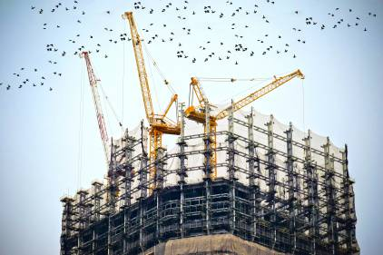 Construction crane on building
