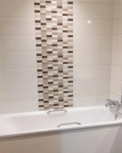 bath with tile feature